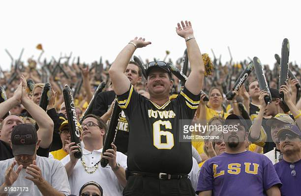 Iowa Hawkeyes fan watches the action on the field during the Capital One Bowl game against the LSU Tigers at the Florida Citrus Bowl on January 1...