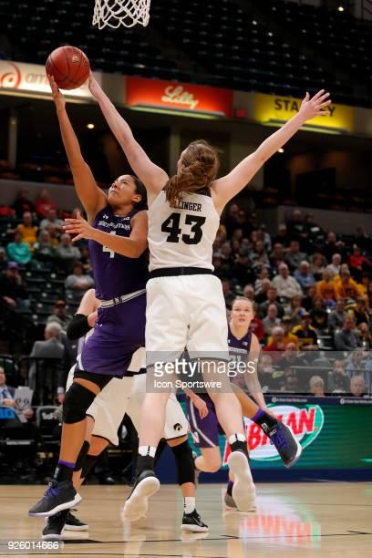 Iowa Hawkeyes forward Amanda Ollinger blocks the shot of Northwestern Wildcats forward Bryana Hopkins during the game between the Northwestern...