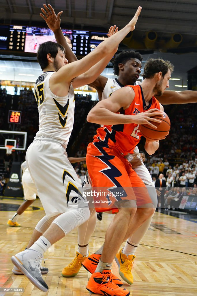 Iowa Hawkeyes forward Ryan Kriener (15) tightly guards Illinois center Maverick Morgan (22) during a Big Ten Conference basketball game between the University of Illinois Fighting Illini and the University of Iowa Hawkeyes on February 18, 2017, at Carver-Hawkeye Arena in Iowa City, IA.