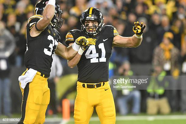 Iowa Hawkeyes free safety Brandon Snyder and Iowa Hawkeyes wide linebacker Bo Bower celebrate after a defensive stop during a Big Ten Conference...
