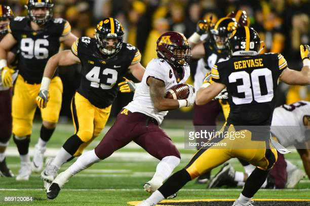 Iowa Hawkeyes' free safety Jake Gervase gets ready to tackle Minnesota Gophers tailback Rodney Smith during a Big Ten Conference football game...