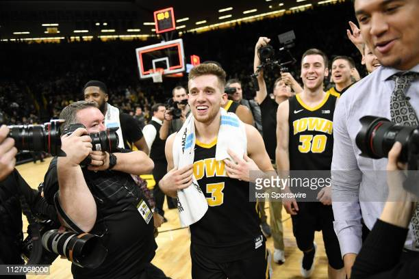 Iowa Hawkeyes guard Jordan Bohannon comes off the court after rallying Iowa to an overtime win during a Big Ten Conference basketball game between...