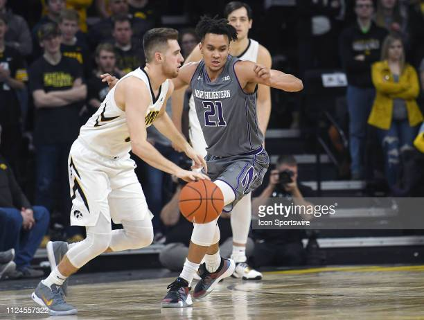 Iowa Hawkeyes guard Jordan Bohannon dribbles past Northwestern Wildcats forward AJ Turner during a Big Ten Conference basketball game between the...