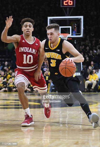 Iowa Hawkeyes guard Jordan Bohannon drives to the basket guarded by Indiana Hoosiers guard Rob Phinisee during a Big Ten Conference basketball game...