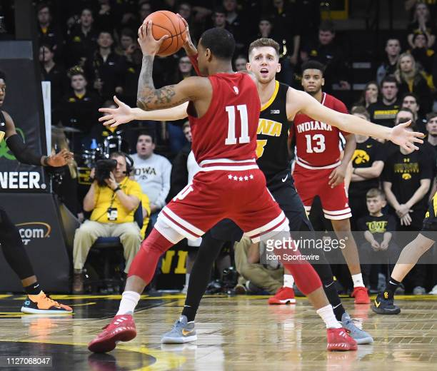 Iowa Hawkeyes guard Jordan Bohannon guards Indiana Hoosiers guard Devonte Green during a Big Ten Conference basketball game between the Indiana...