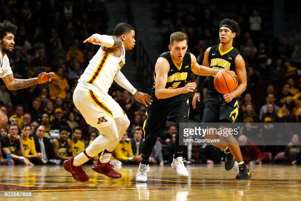 Iowa Hawkeyes guard Jordan Bohannon in action while Minnesota Golden Gophers guard Nate Mason defends during the Big Ten Conference game between the...