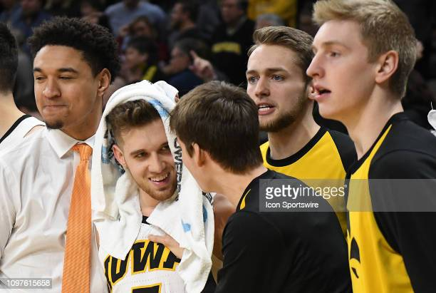 Iowa Hawkeyes guard Jordan Bohannon is congratulated by teammates after sinking the gamewinning shot during a Big Ten Conference basketball game...