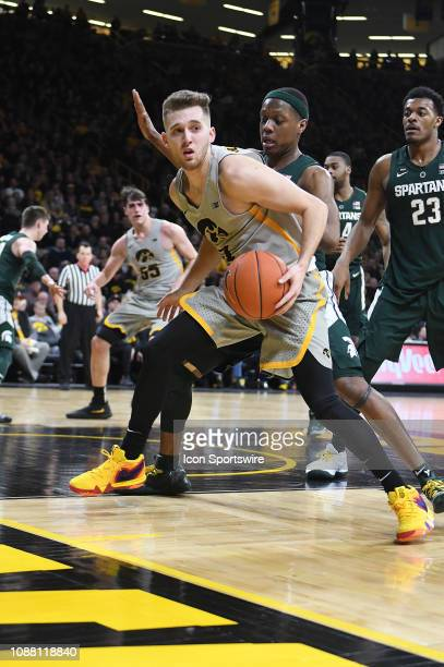 Iowa Hawkeyes guard Jordan Bohannon looks to pass the ball during a Big Ten Conference basketball game between the Michigan State Spartans and the...