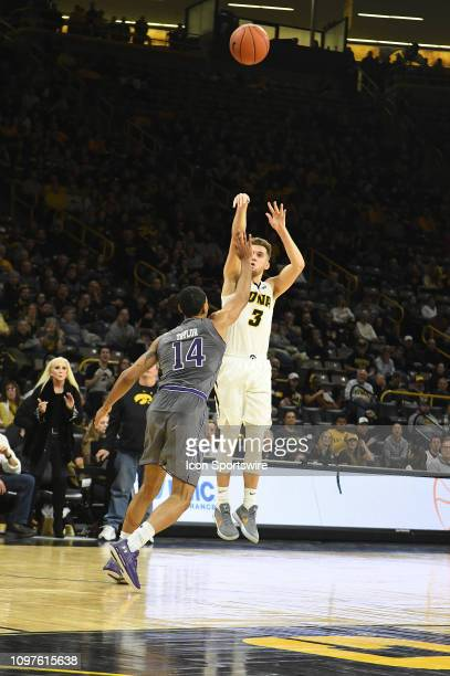 Iowa Hawkeyes guard Jordan Bohannon puts the gamewinning threepoint shot in the final three seconds during a Big Ten Conference basketball game...