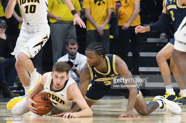 Iowa Hawkeyes guard Jordan Bohannon recovers a loose ball during a Big Ten Conference basketball game between the Michigan Wolverines and the Iowa...