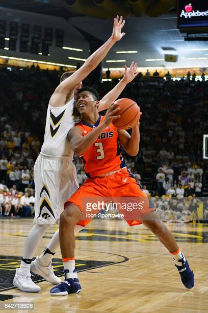 Iowa Hawkeyes guard Jordan Bohannon tightly guards Illinois guard Te'Jon Lucas during a Big Ten Conference basketball game between the University of...