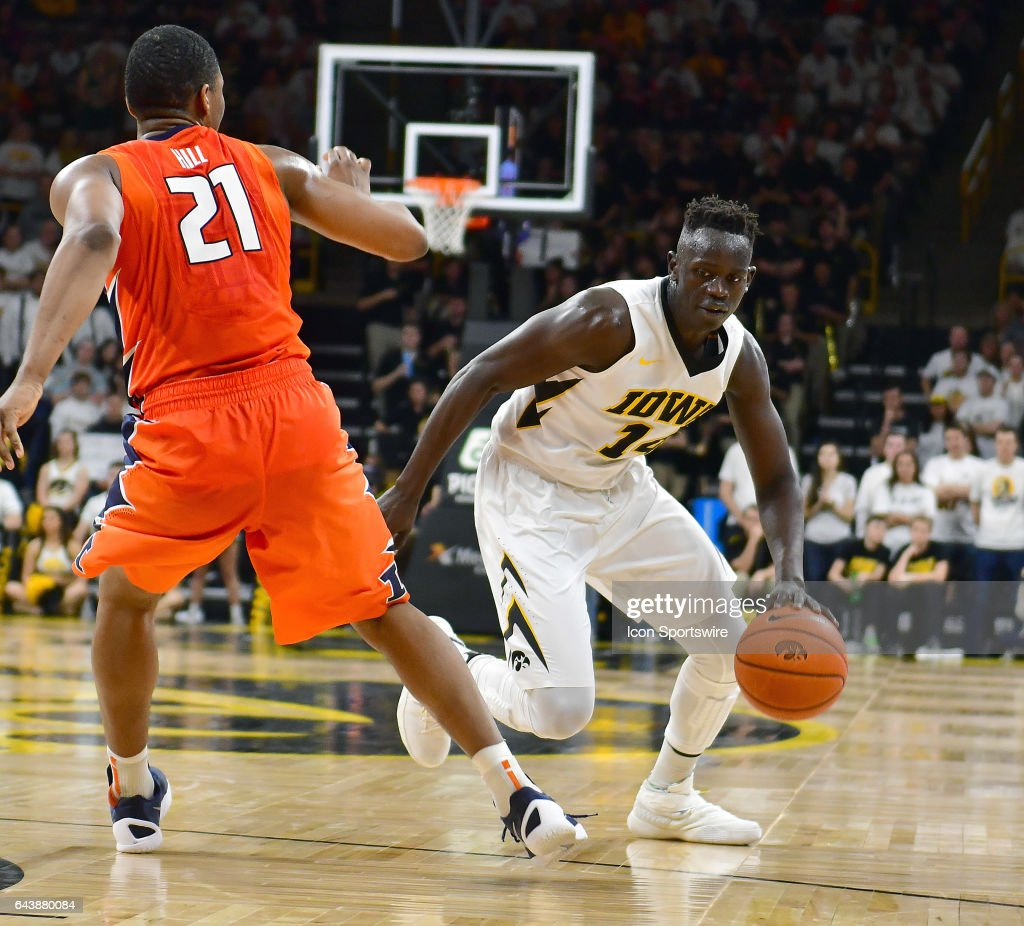 Iowa Hawkeyes' guard Peter Jok (14) tries to dribble azround Illinois guard Malcolm Hill (21) during a Big Ten Conference basketball game between the University of Illinois Fighting Illini and the University of Iowa Hawkeyes on February 18, 2017, at Carver-Hawkeye Arena in Iowa City, IA.