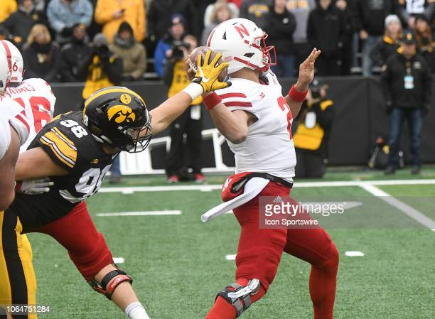 Iowa Hawkeyes left end Anthony Nelson tips a pass by Nebraska Cornhuskers quarterback Adrian Martinez during a Big Ten Conference football game...