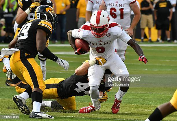 Iowa Hawkeyes outside linebacker Ben Niemann tackles Miami RedHawks wide receiver Rokeem Williams during a nonconference NCAA football game between...
