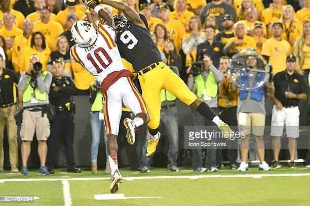 Iowa Hawkeyes split end Jerminic Smith can't haul in a pass over Iowa State Cyclones defensive back Brian Peavy during nonconference NCAA football...
