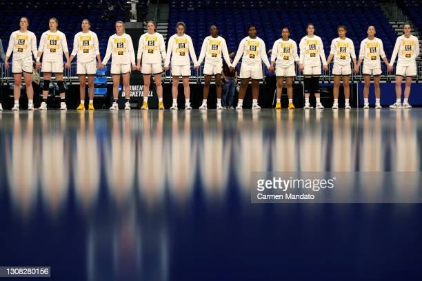 Iowa Hawkeyes stand for the national anthem in the first round game of the 2021 NCAA Women's Basketball Tournament against the Central Michigan...
