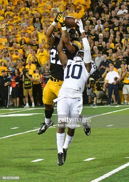 Iowa Hawkeyes' strong safety Amani Hooker and Penn State wide receiver Brandon Polk compete for a pass during a Big Ten Conference football game...