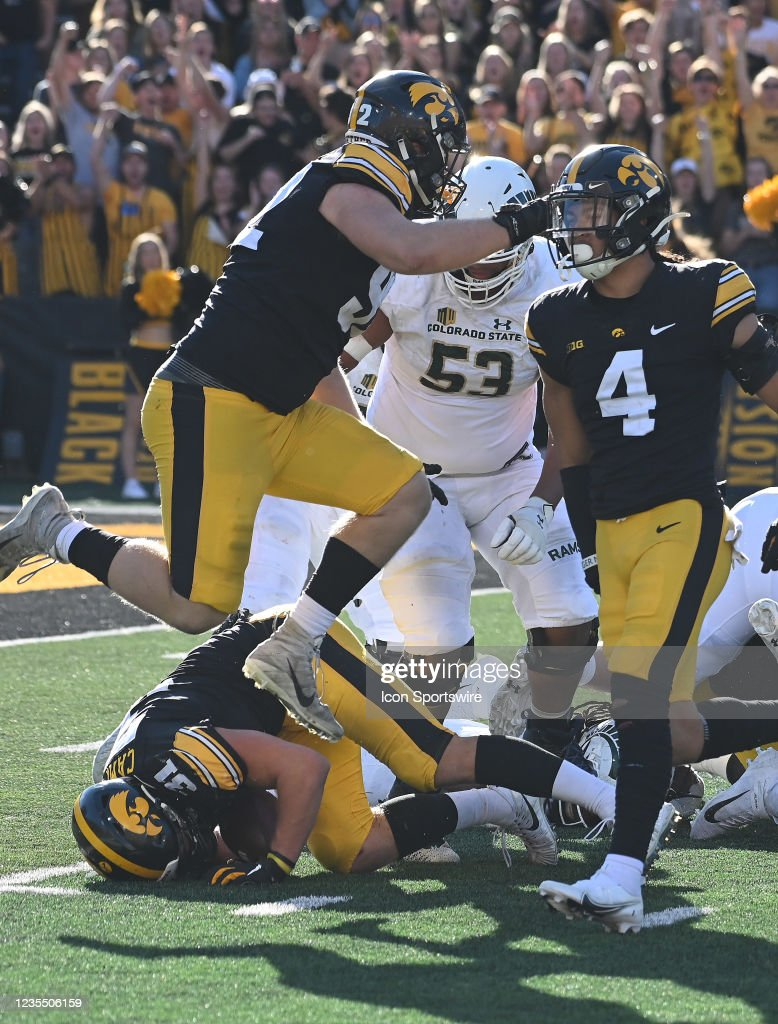 Iowa linebacker Jack Campbell recovers a fumble during a ...
