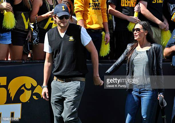 Iowa native and actor Ashton Kutcher and his wife actress Demi Moore watch from the sidelines of the University of Iowa Hawkeyes and Iowa State...