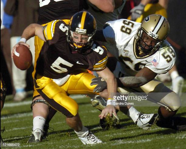 Iowa quarterback Drew Tate escapes from the grasp of Purdue's Stanford Keglar for a gain in the 1st quarter of Iowa's 2321 win against Purdue...