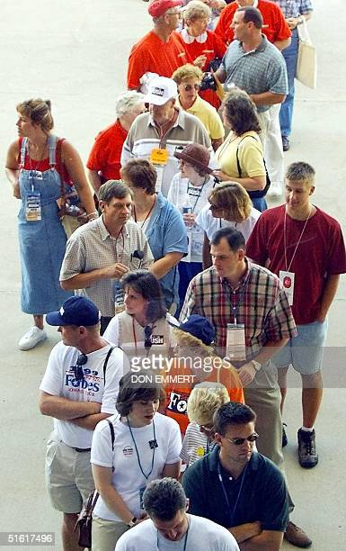 Iowa Republicans line up to cast their votes in the unofficial Republican straw poll at Iowa State University 14 August 1999 in Ames Iowa Thousands...