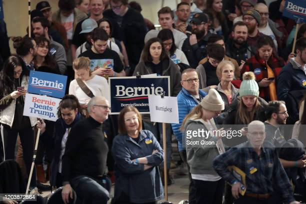 Iowa residents attend a caucus to select a Democratic nominee for president on February 03 2020 in Des Moines Iowa Iowa is the first contest in the...