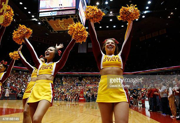 Iowa State Cyclone cheerleaders cheer on their team in the first half of play against Oklahoma State at Hilton Coliseum on March 8 2014 in Ames Iowa...