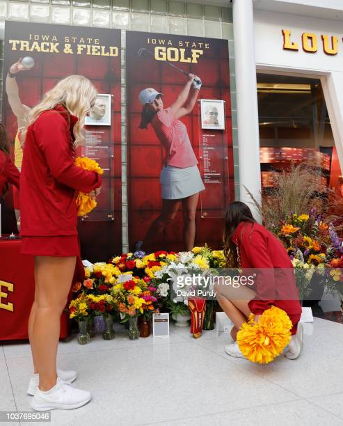 Iowa State Cyclones cheerleaders pause at a memorial in the Jacobson Building honoring Celia Barquin Arozamena at Jack Trice Stadium on September 22...