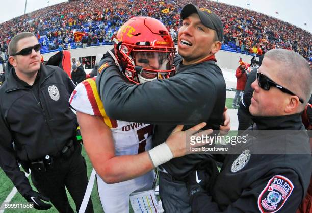 Iowa State Cyclones coach Matt Campbell hugs quarterback Joel Lanning after winning the AutoZone Liberty Bowl game between the Memphis Tigers and the...
