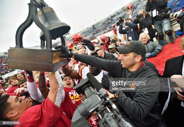 Iowa State Cyclones coach Matt Campbell passes the trophy off to his players after winning a NCAA college football game against the Memphis Tigers in...