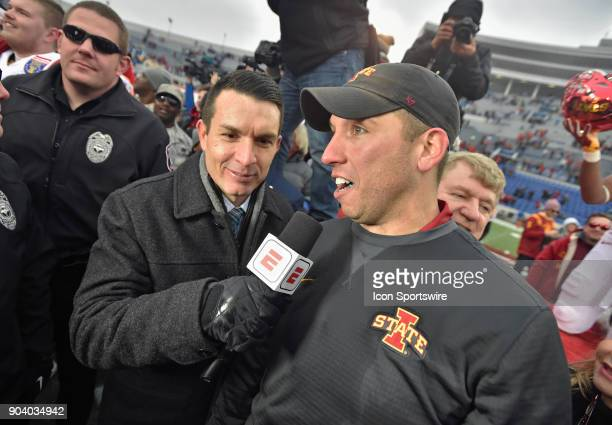 Iowa State Cyclones coach Matt Campbell talks with ESPN reporter Paul Carcaterra during postgame of a NCAA college football game against the Memphis...
