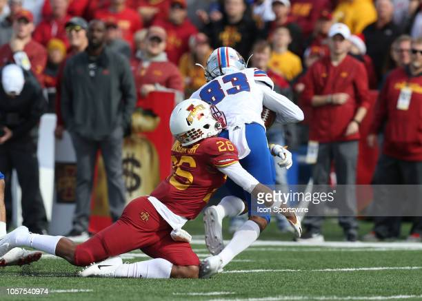 Iowa State Cyclones defensive back Anthony Johnson tackles Kansas Jayhawks wide receiver Kwamie Lassiter II in the fourth quarter of a Big 12...