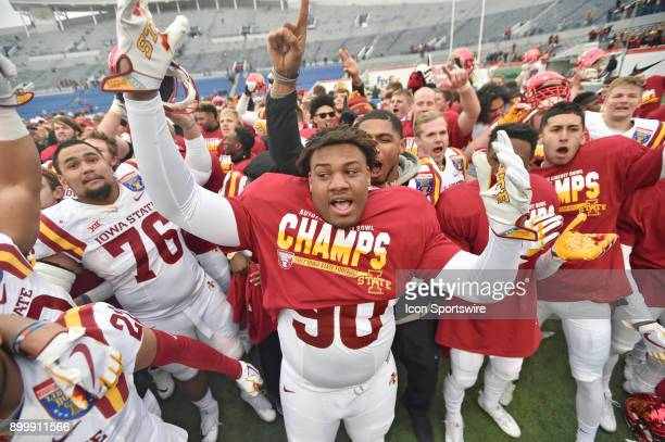 Iowa State Cyclones defensive tackle Joshua Bailey celebrates with his teammates after winning the AutoZone Liberty Bowl game between the Memphis...