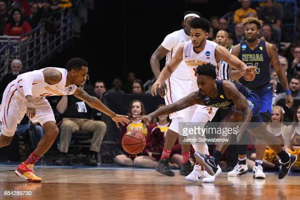 Iowa State Cyclones guard Monte Morris and Nevada Wolf Pack guard Marcus Marshall fight for a loose ball during the 2017 NCAA Photos via Getty Images...