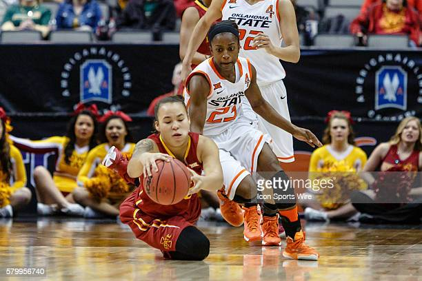 Iowa State Cyclones guard Nicole Blaskowsky and Oklahoma State Cowgirls guard Roddricka Patton scramble for a loose ball during the NCAA Big 12...