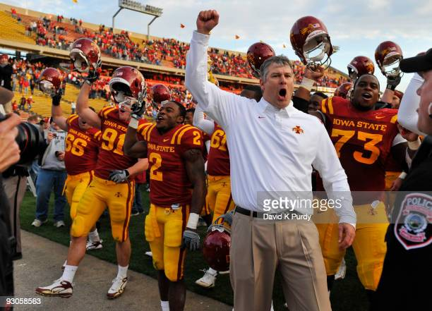 Iowa State Cyclones head coach Paul Rhoads celebrates with his team after their win over the Colorado Buffaloes at Jack Trice Stadium on November 14,...