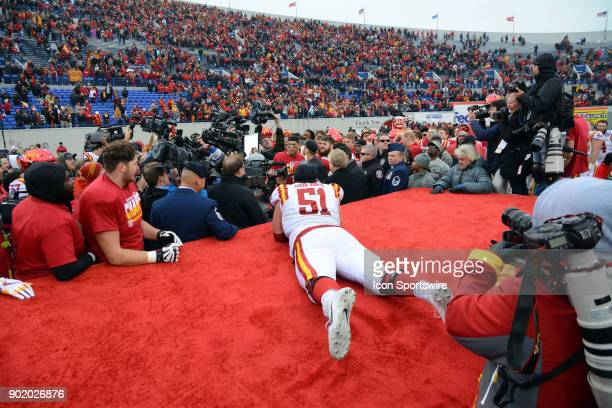 Iowa State Cyclones Julian GoodJones observes the trophy presentation as he lays on the broken presentation stage during the AutoZone Liberty Bowl...