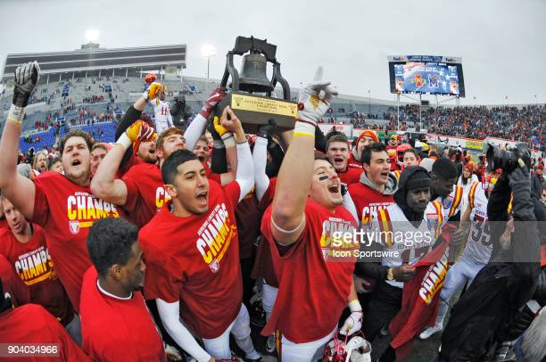 Iowa State Cyclones players celebrate with the Liberty Bowl trophy after winning a NCAA college football game against the Memphis Tigers in the...