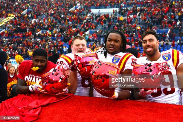 Iowa State Cyclones players celebrating with their helmets upside down during the AutoZone Liberty Bowl game between the Memphis Tigers and the Iowa...