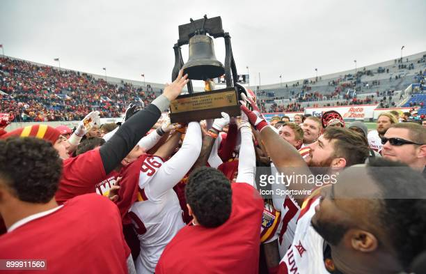 Iowa State Cyclones players lift the Liberty Bowl trophy after winning the AutoZone Liberty Bowl game between the Memphis Tigers and the Iowa State...