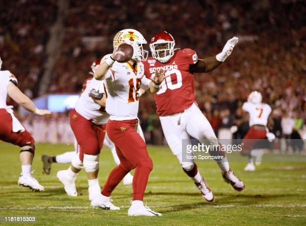 Iowa State Cyclones QB Brock Purdy looks to pass as Oklahoma Sooners DL Neville Gallimore closes in on a sack attempt during a college football game...