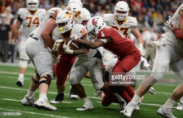 Iowa State Cyclones RB David Montgomery gets tackled by Marcus Strong during Valero Alamo Bowl against the Washington State Cougars on December 28...