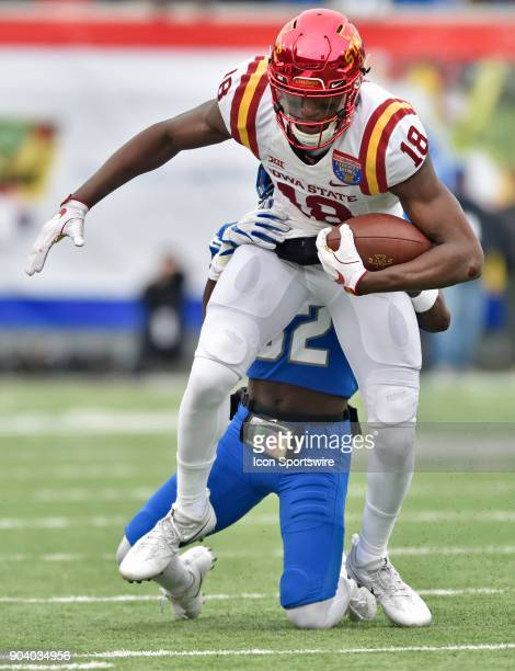 Iowa State Cyclones receiver Hakeem Butler tries to break free of a Memphis Tigers defender during the second quarter of a NCAA college football game...