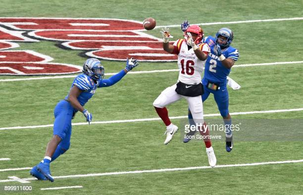 Iowa State Cyclones receiver Marchie Murdock looks in a pass between two Memphis Tigers defenders during the third quarter during the AutoZone...