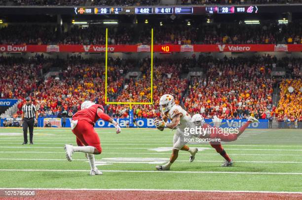 Iowa State Cyclones running back David Montgomery is stopped on the two point conversion by Washington State Cougars cornerback Marcus Strong during...