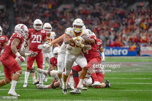 Iowa State Cyclones running back David Montgomery runs through a tackle during the Alamo Bowl between the Washington State Cougars and Iowa State...