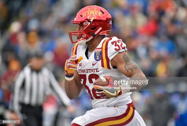 Iowa State Cyclones running back David Montgomery runs upfield during the first quarter of the AutoZone Liberty Bowl game between the Memphis Tigers...