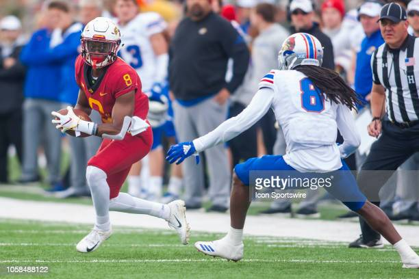 Iowa State Cyclones wide receiver Deshaunte Jones attempts to avoid the tackle of Kansas Jayhawks cornerback Shakial Taylor during the Big 12 matchup...
