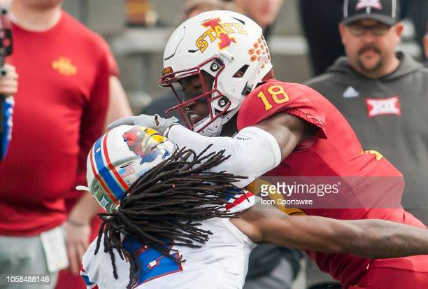 Iowa State Cyclones wide receiver Hakeem Butler stiff arms Kansas Jayhawks cornerback Corione Harris for extra yardage after a completion during the...