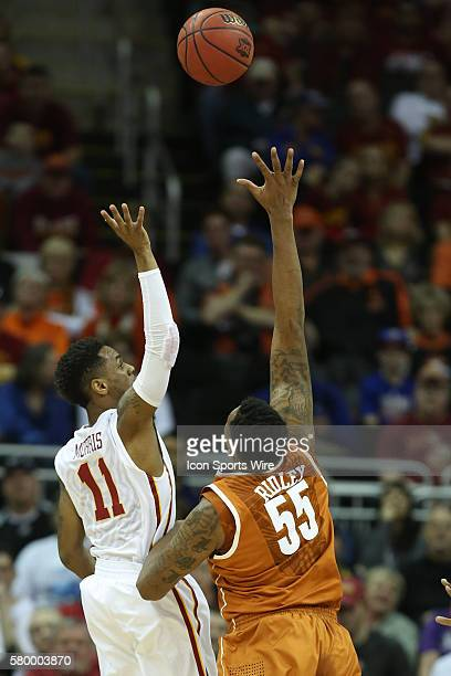 Iowa State guard Monte Morris puts up a floater over the defending Texas forward Cameron Ridley during the Thursday game between Iowa State and Texas...